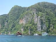 boats-behind-limestone-moun