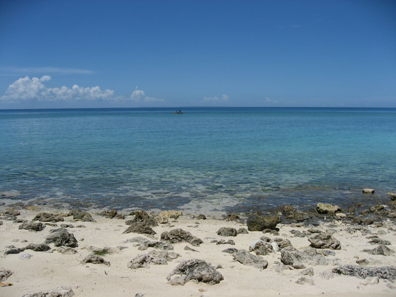 deserted.beach.cove.malapascua.jpg