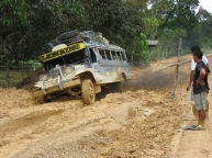 Jeepney going all in through the muddy path