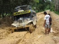 jeepney stuck in mud
