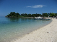 1.beach.on.the.western.side.of.Guimbitayan.with.fishermens.bancas.jpg