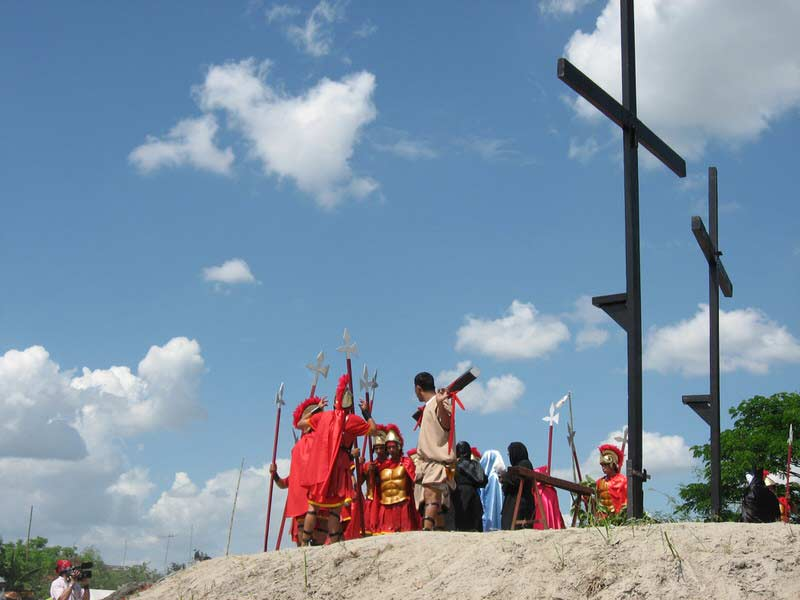 The start of the most realistic passion play where the participants are voluntarily nailed to the cross.