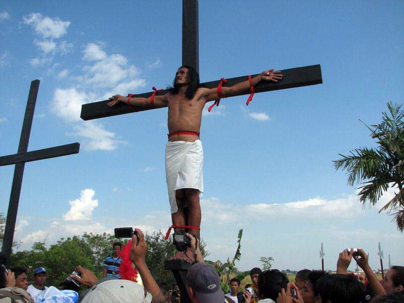 Frontal view of the now fully crucified penitent completing his true test of his faith to God. The festival is now at its climax..