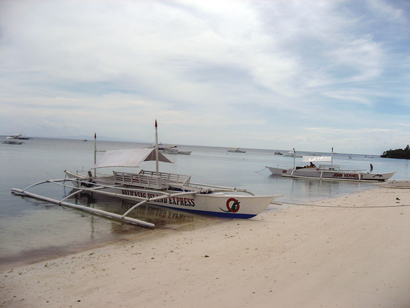 2 bangka boat on the beach